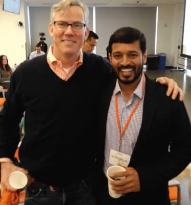 Raj with Brian Halligan in HubSpot event