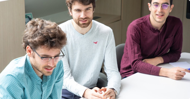 Three Male Employees in a Meeting