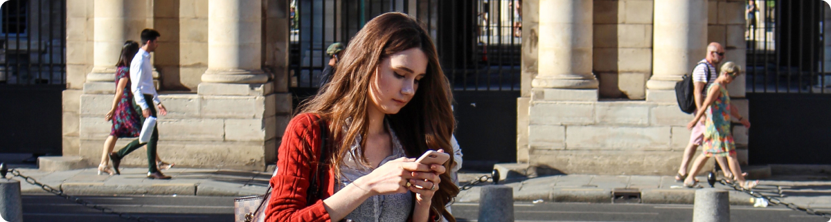 Woman on the Street Using Her Phone
