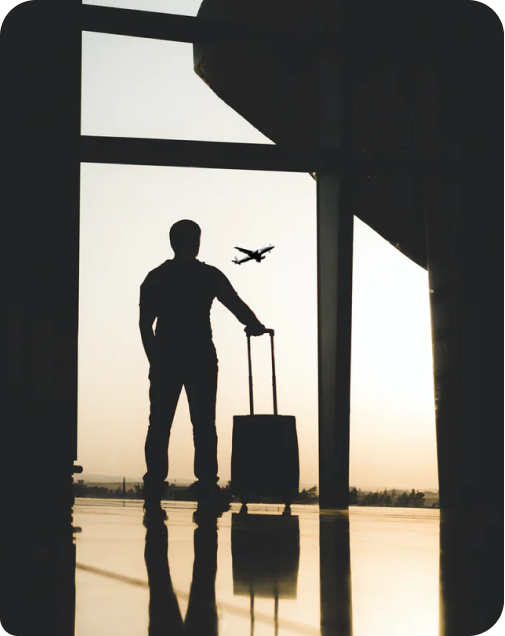 Person at airport watching a plane take-off