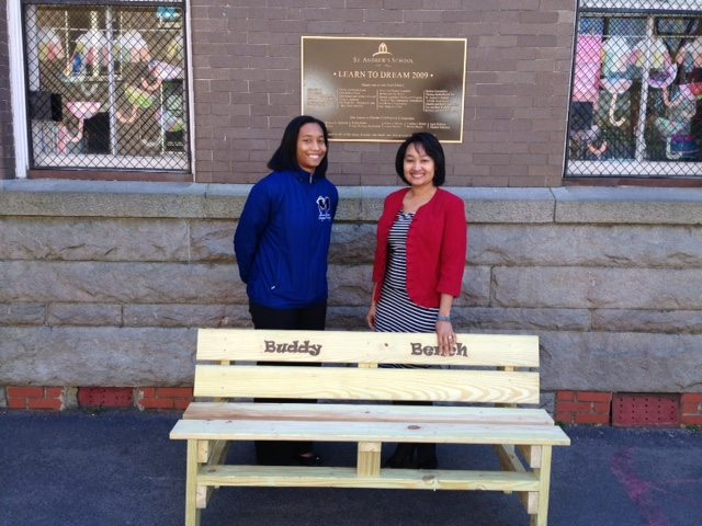 TDT caseworker Brianna Dillard-Dula presents Buddy Bench to St. Andrews Episcopal head of School, Dr. Cyndy Weldon-Lassiter.