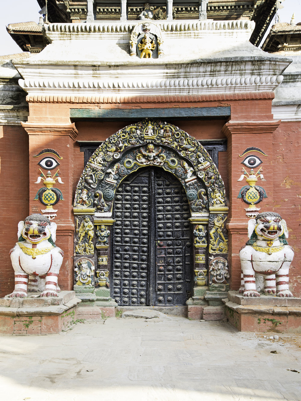 This door stands proudly in Durbar Square.  The colorful statues, colorful frame, and texture on the door really drew me to it.