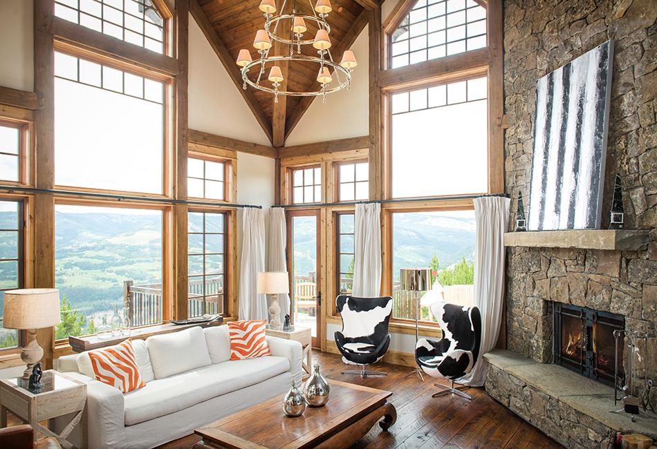 I love when interior designers choose the unexpected and surprise me with the cool patterns.  I love the animal prints and pops of color in this room.  The views aren't too shabby either!