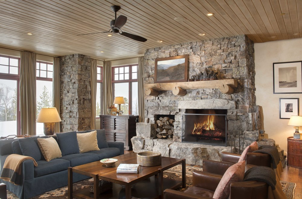 The room is the perfect family room, I could see family game nights down here. The stonework and fireplace create a really cozy space.