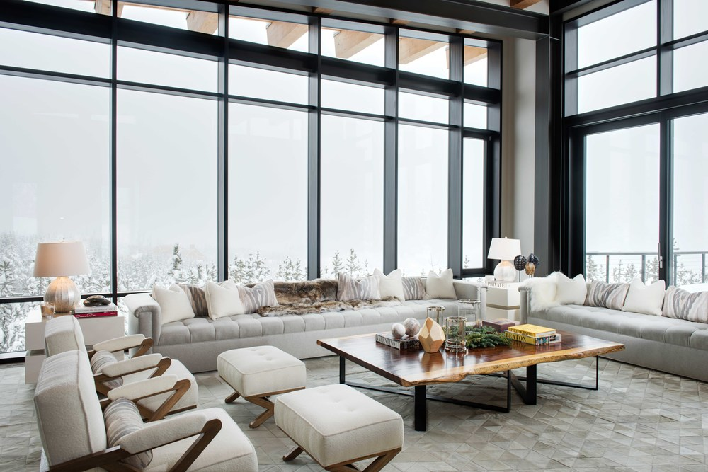 Though the clouds blocked the gorgeous mountain views, the whites on the trees really complimented the bright furnishings.  The interiors of this   Reid Smith   home were designed by   Anna Burke Interiors   - they did a fabulous job! The 15 foot cashmere couch is a place I could relax for a long while!
