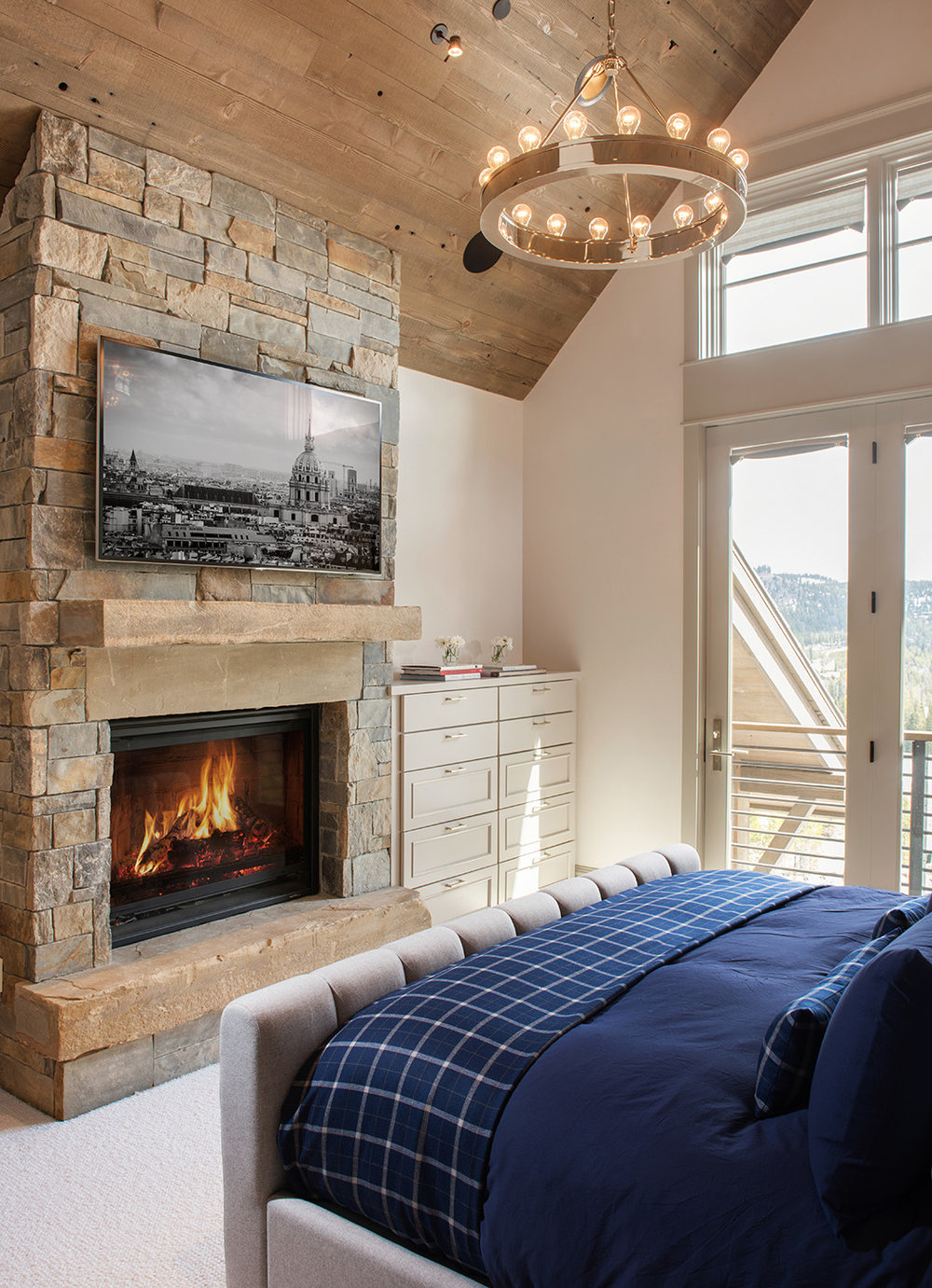Who doesn't love a fireplace in their master bedroom?  The walk out deck is a nice addition too!  Architect -  Locati Architects
