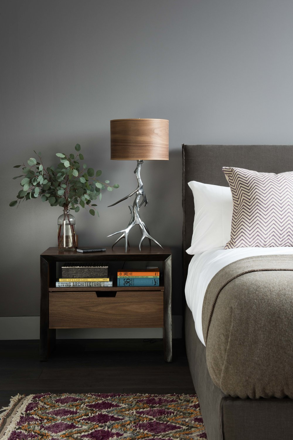 Classic and sophisticated!  The bedside table lamp & the rug are my favorites in this guest bedroom.