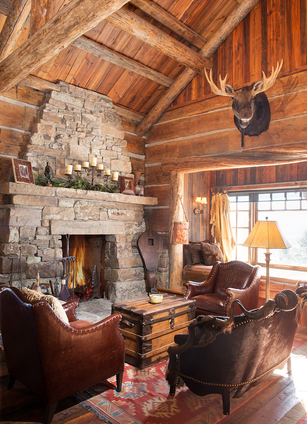 This cozy cabin was originally designed to mimic the iconic lodges of Yellowstone National Park.  The stonework and cabin architecture makes this an incredible cozy space to lounge after a day on the  Yellowstone Club  ski hill.