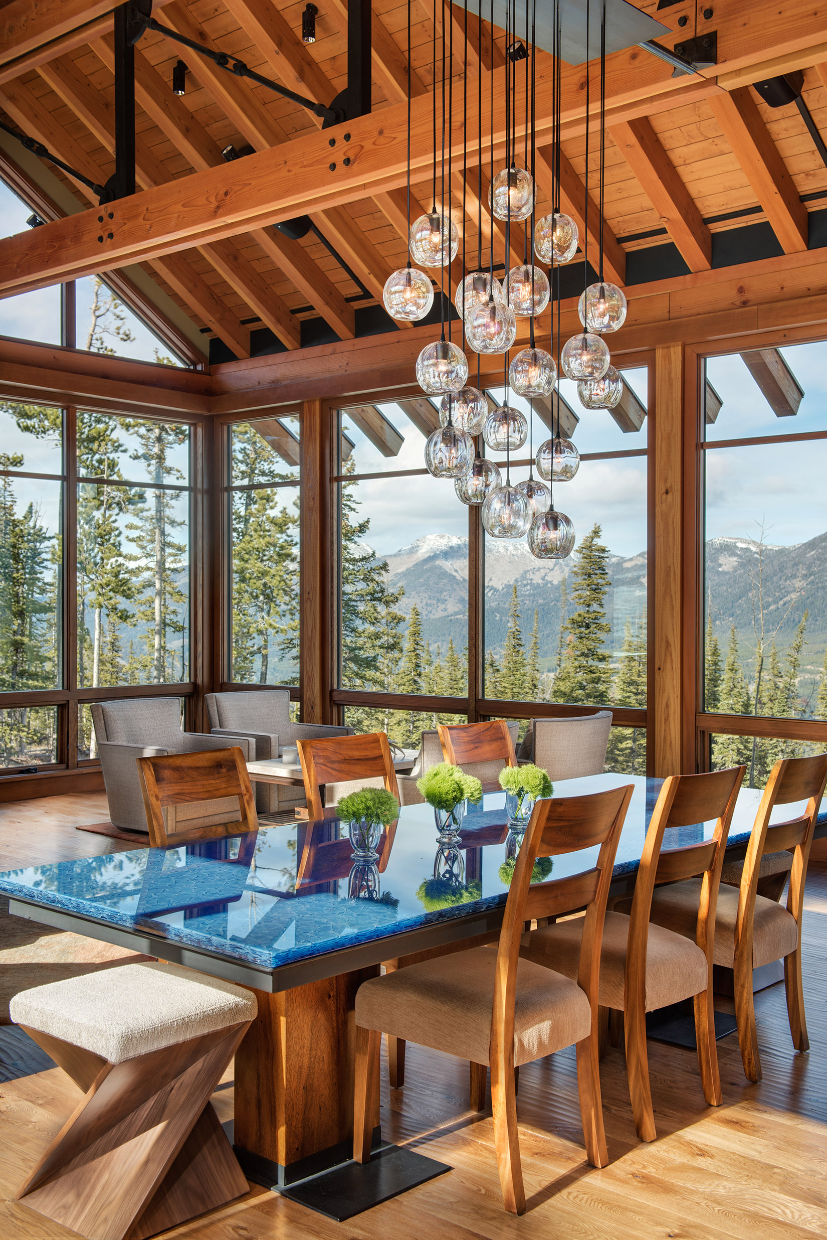 This room is AMAZING!!  The walls of glass over looking the Spanish Peaks is incredible!  What really draws my eye is the gorgeous light fixture over the dining table.  Interior Design -  Varda Interiors  Architect -  Krannitz Gehl Architects