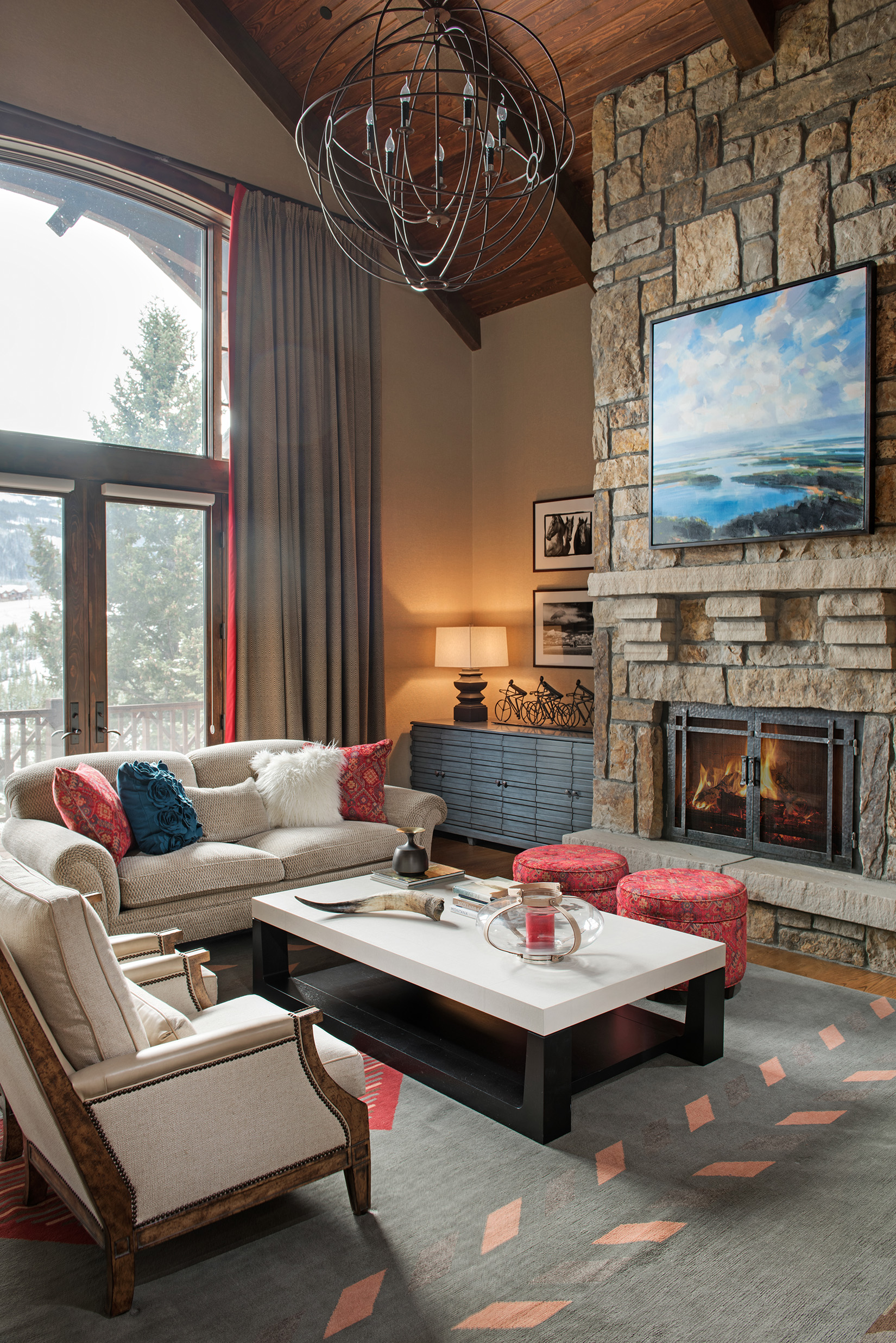 I love all the furnishings in this  Yellowstone Club  home great room, but what really stands out is the custom coffee table. Gorgeous! Interior Design -  Varda Interiors