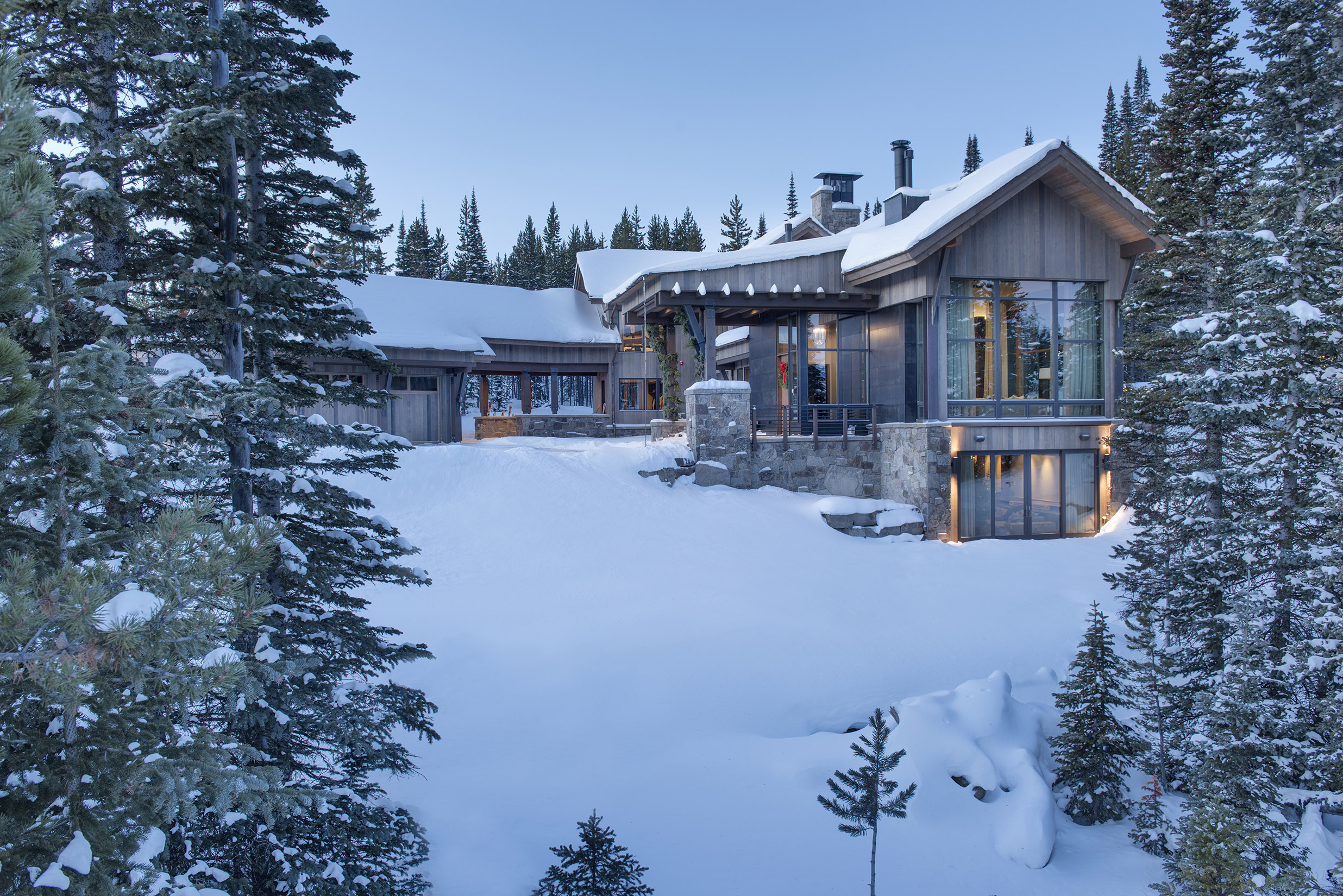 This gorgeouse Spanish Peaks Moutnain Club home was photographed early one very snowy morning.  It's such a cozy home tucked back on the mountain.  Architect -  Centre Sky Architecture ,  Builder -  Big Sky Build