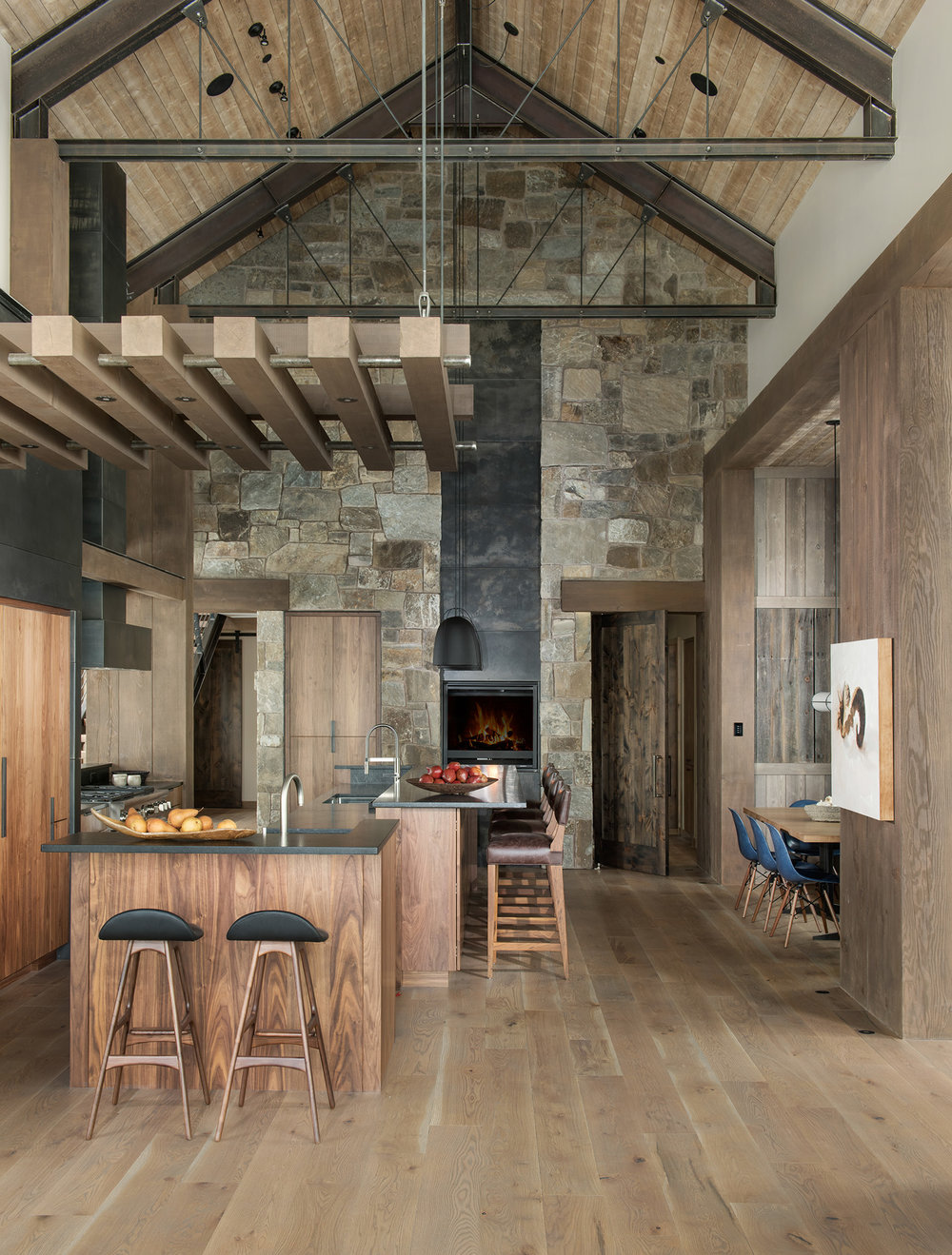 I love the combination of the large stone wall, the natural color palette, & pops of color! Architecture Design by  Centre Sky Architecture  Interior Design by  Peace Design