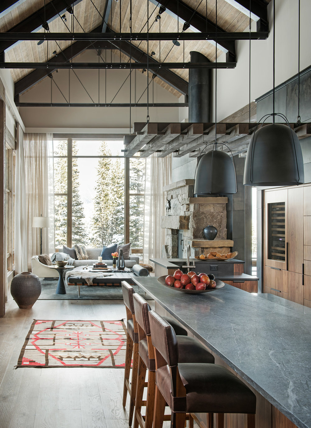 The vaulted ceilings make the space feel very grand.  I love the use of steel and wood. Gorgeous!