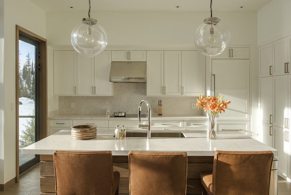 The sun setting cast the perfect light into this elegant, contemporary kitchen.  Architecture Design by  Reid Smith Architects