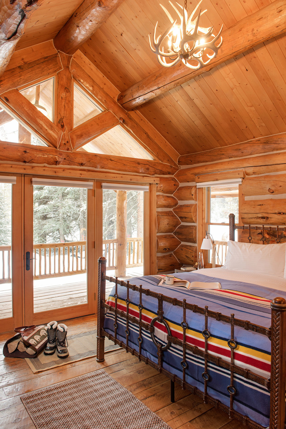Nothing says rustic like a quaint little cabin on the river. The custom woodwork and setting really create that cozy, rustic feel. Located at  Yellowstone Club .