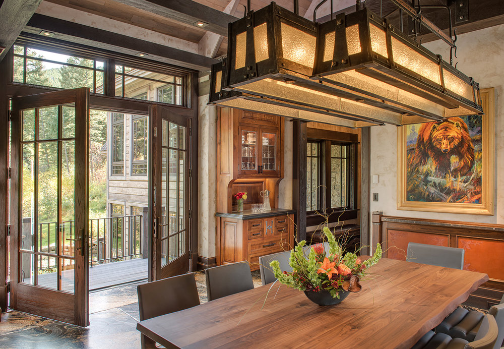 The word to describe this dining room is grand.  Everything about it exudes grandeur - and I am loving the French doors out to the deck!   L and K Real Estate