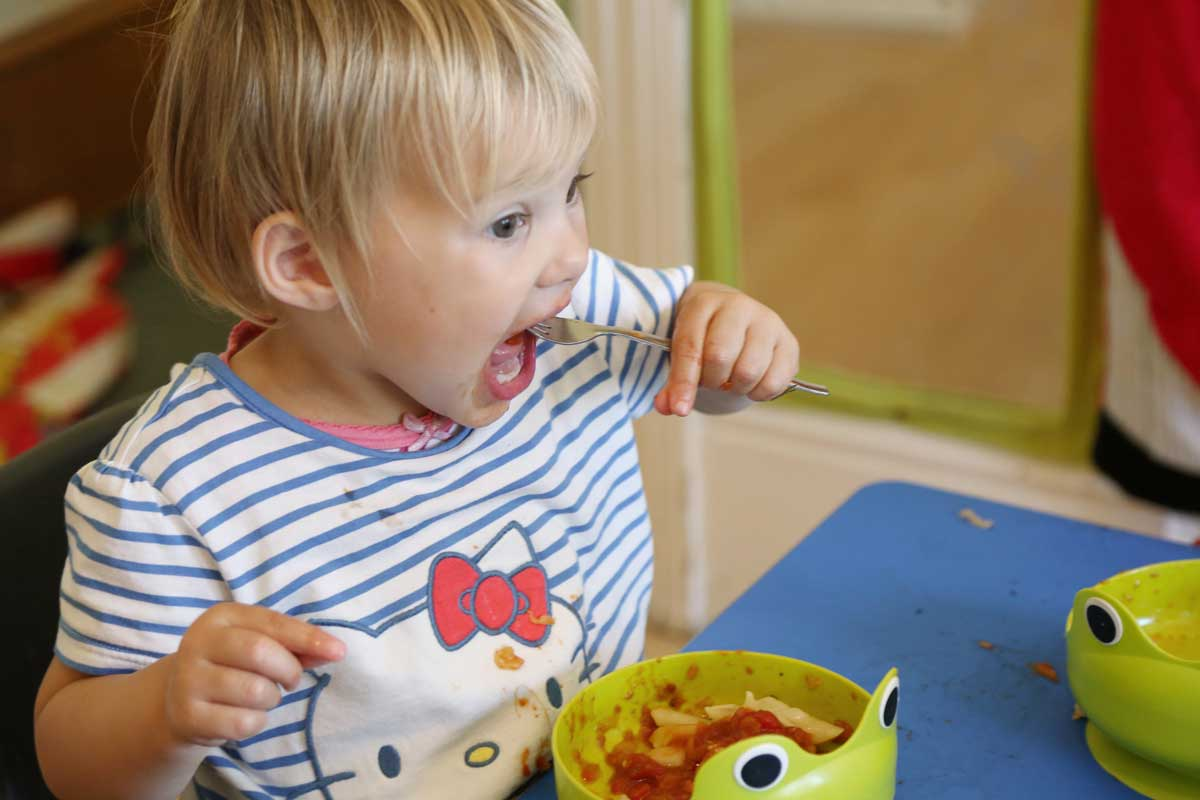 photo of a child eating lunch