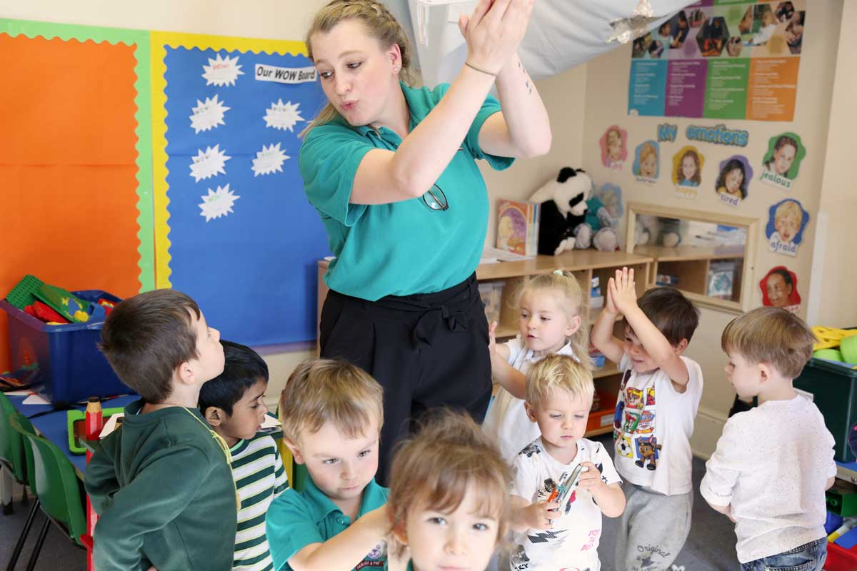 photo of children dancing with their child-minder