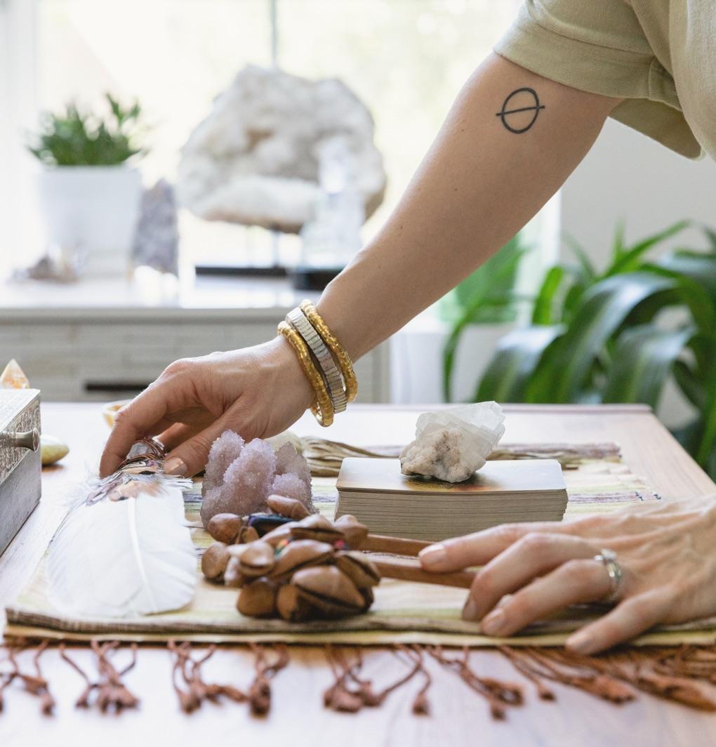 Meribeth's hands arranging totems