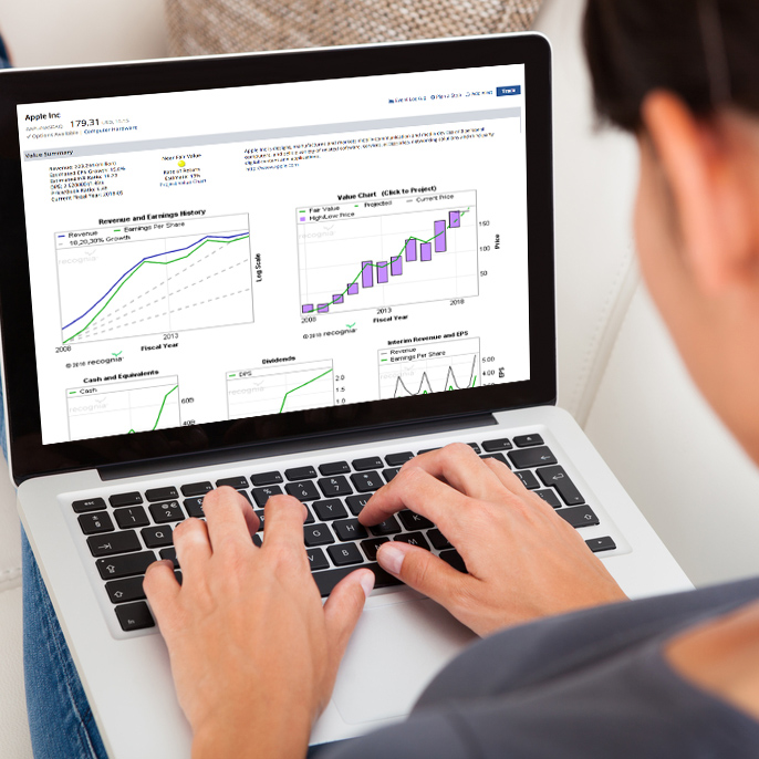Investor using Value Analyzer on a desktop. Explore fair value investments