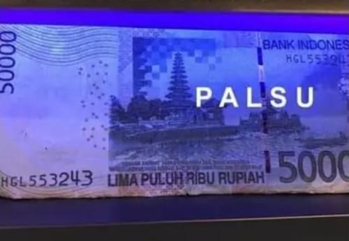 Contoh gambar uang palsu yang tidak memiliki tinta UV