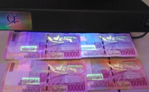 Contoh gambar uang asli yang memiliki tinta UV