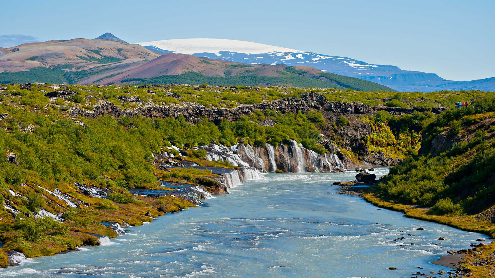View of Hraunfossar waterfall towards Langjökull