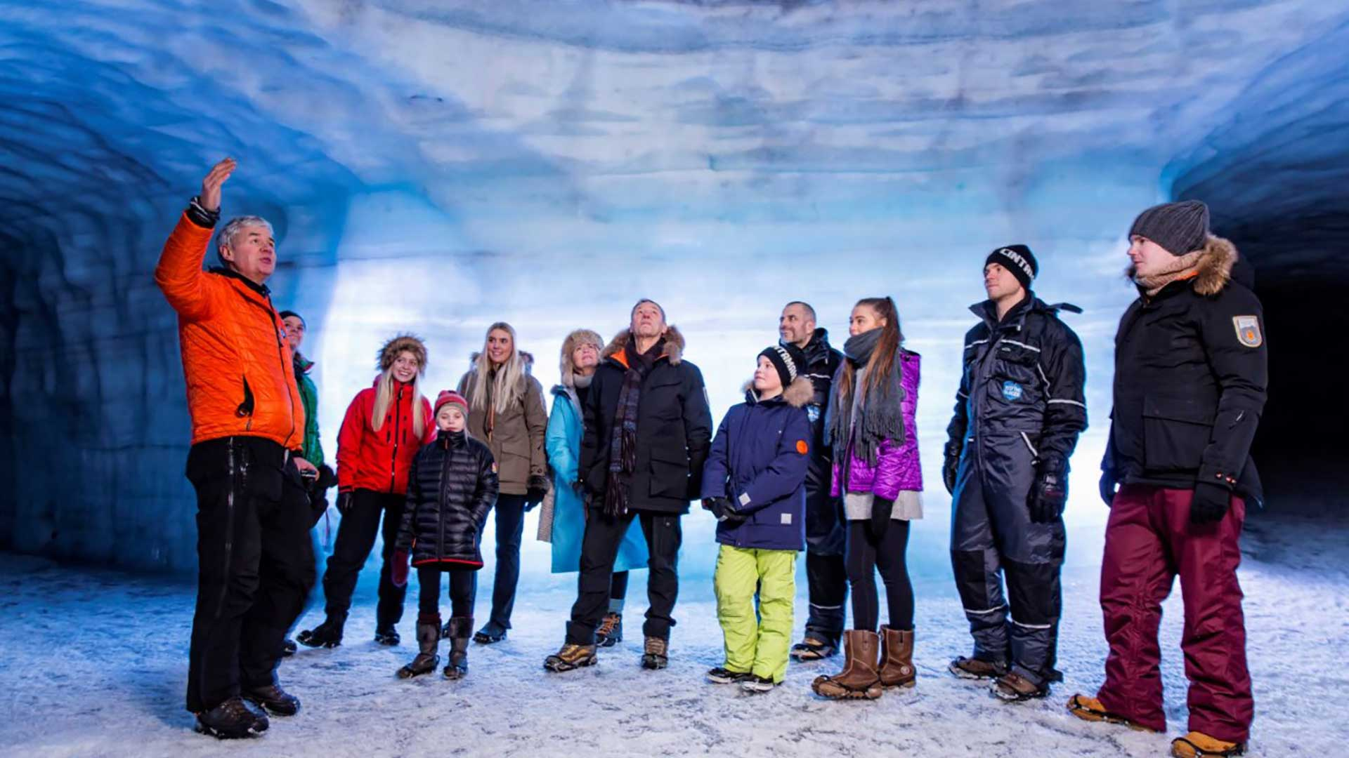 A family beng guided around in the Ice Caves.