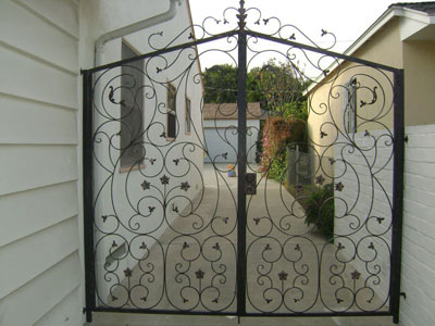Custom Dual Iron Swinging Doors for Backyards