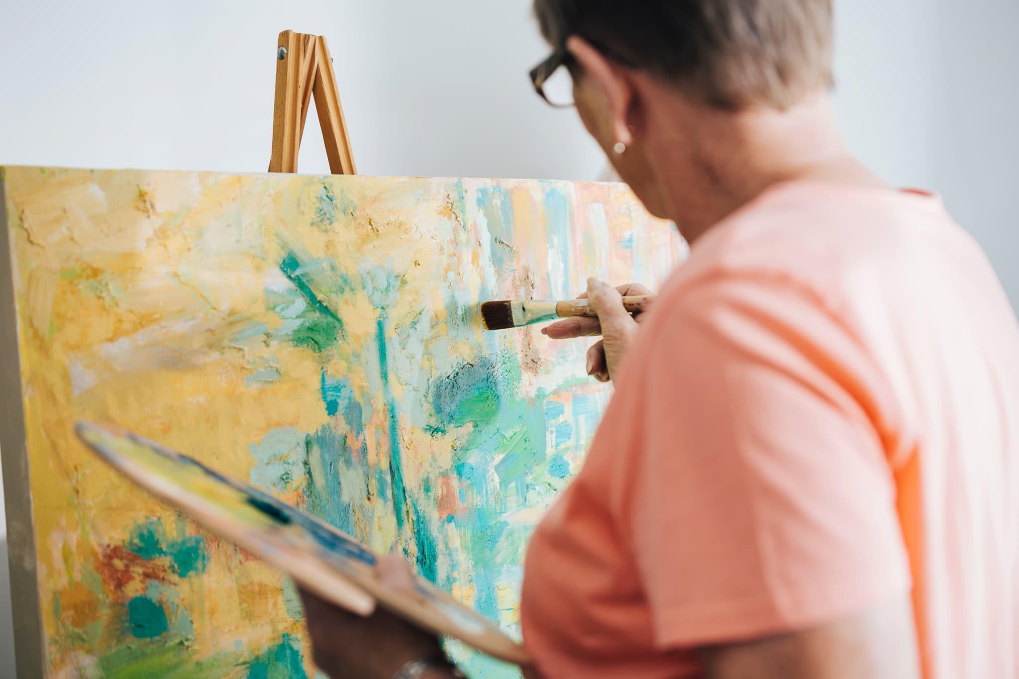 senior, woman painting, paintbrush, senior living
