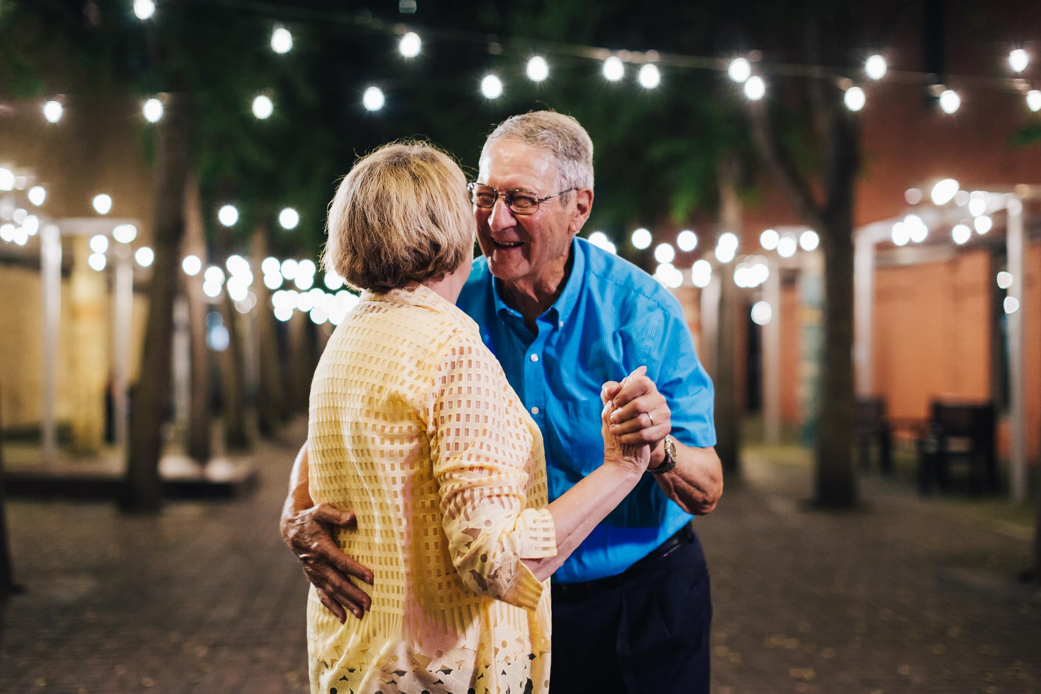 Friendship residents, couple dancing, string lights,