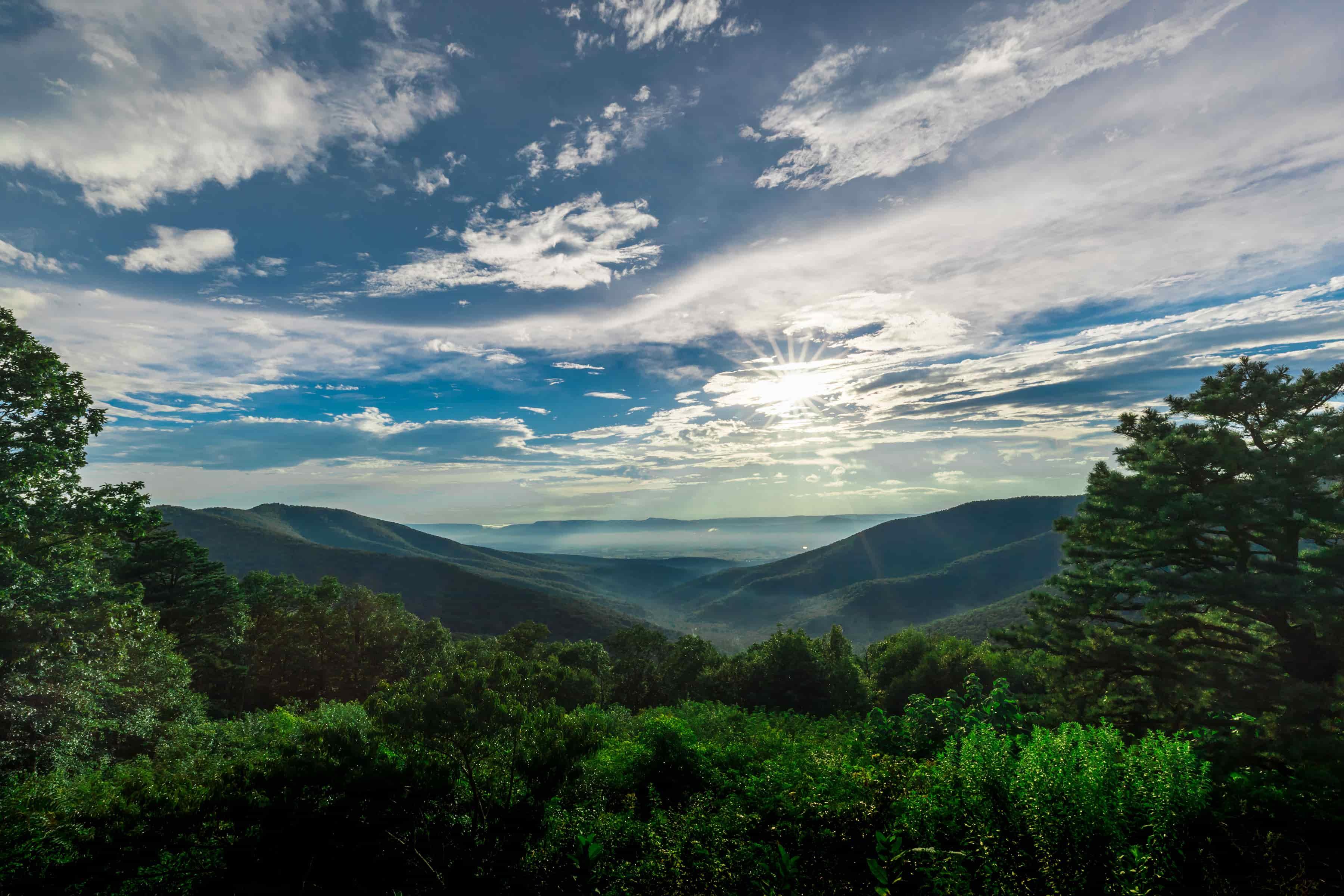 Shenandoah Valley, Blue Ridge Mountains, Sunlit cloudy sky over lush green mountains