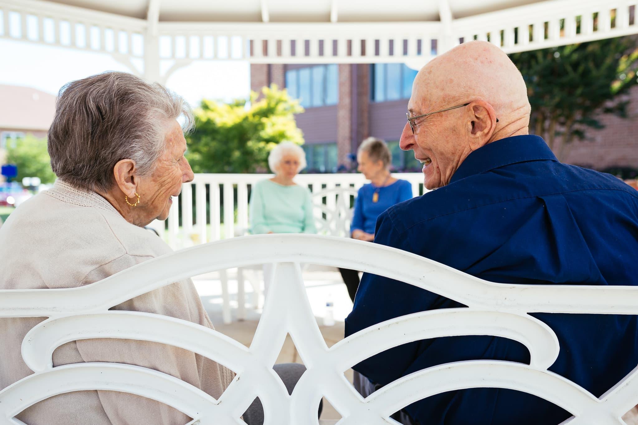 Couple, gazebo, park bench, seniors, friends talking