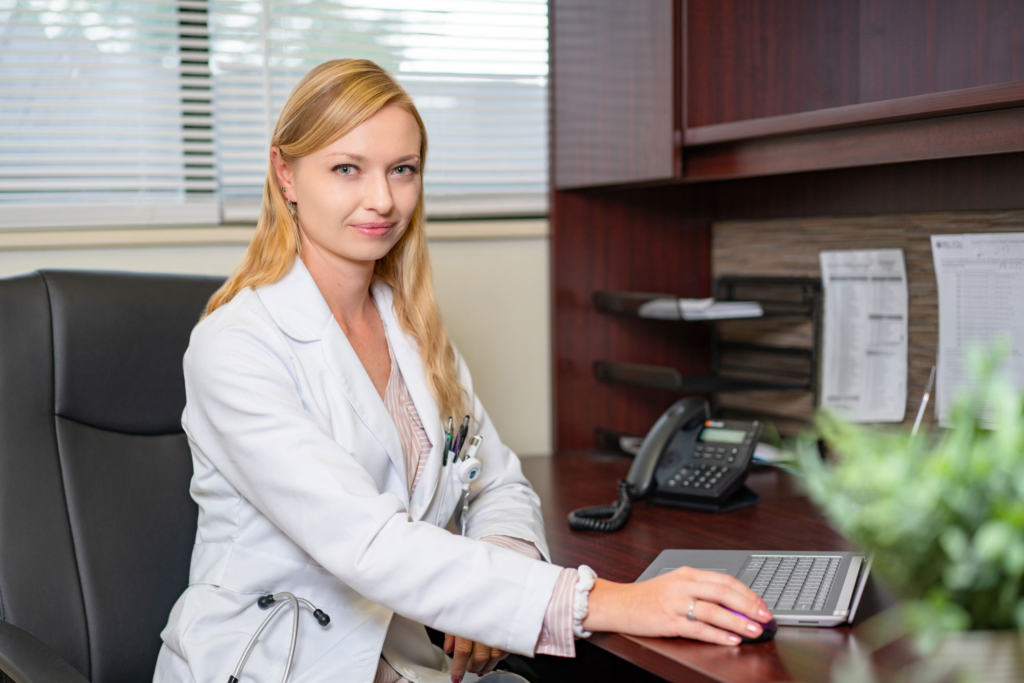 Health professional at desk, Friendship Physician Clinic, Nurse Practitioner, Indre Malaiskaite