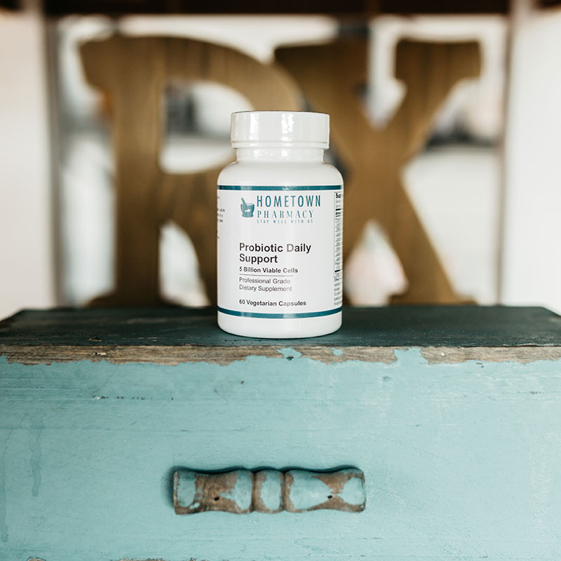 Hometown Pharmacy Probiotic Daily Support on top of a blue wooden box