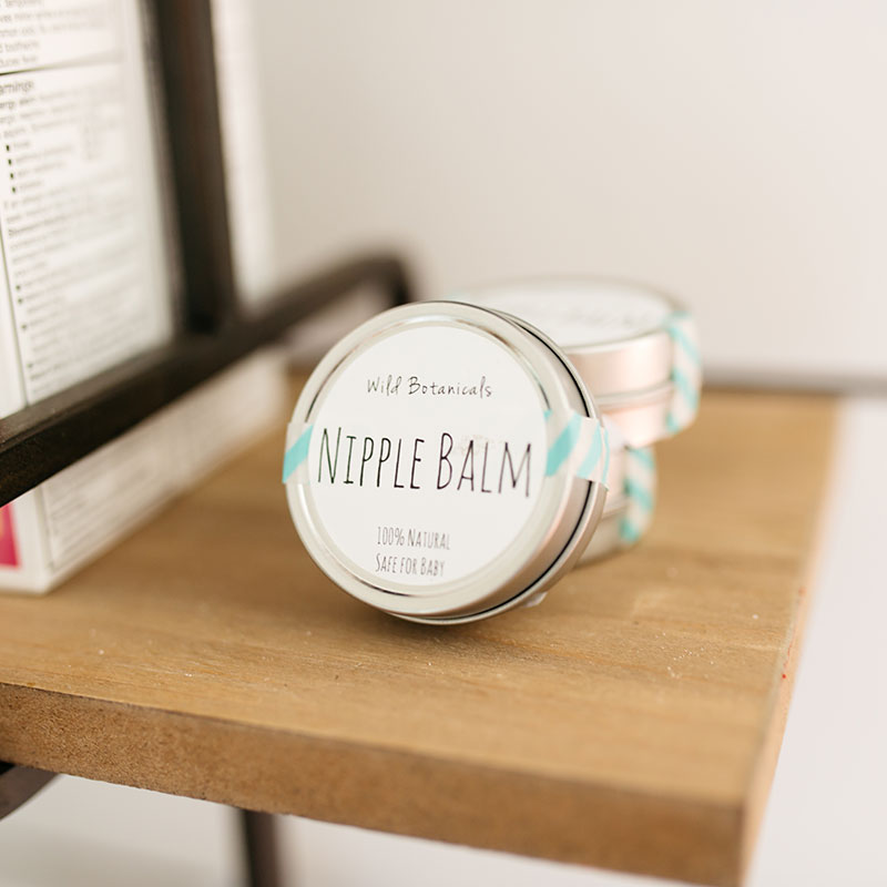 Wild Botanicals Nipple Balm on a wooden desk