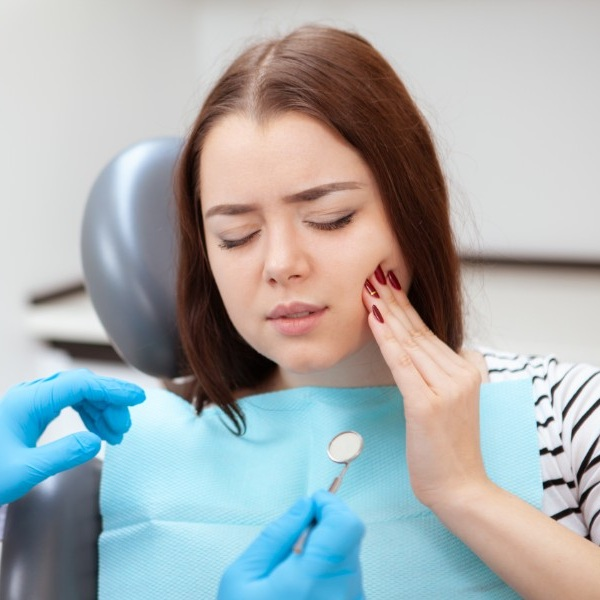 Woman closing her eye in tooth pain