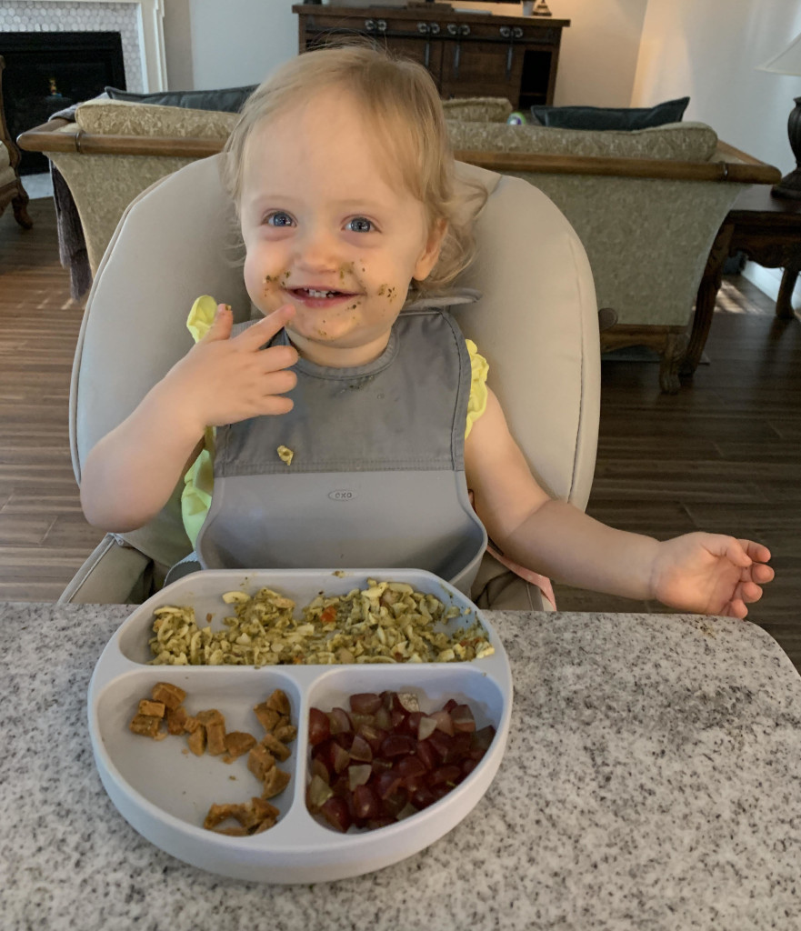 Macy digging into one of her favorite Freshly meals, the Super Pesto and Sausage Fusilli. | Credit: Julie Braatz