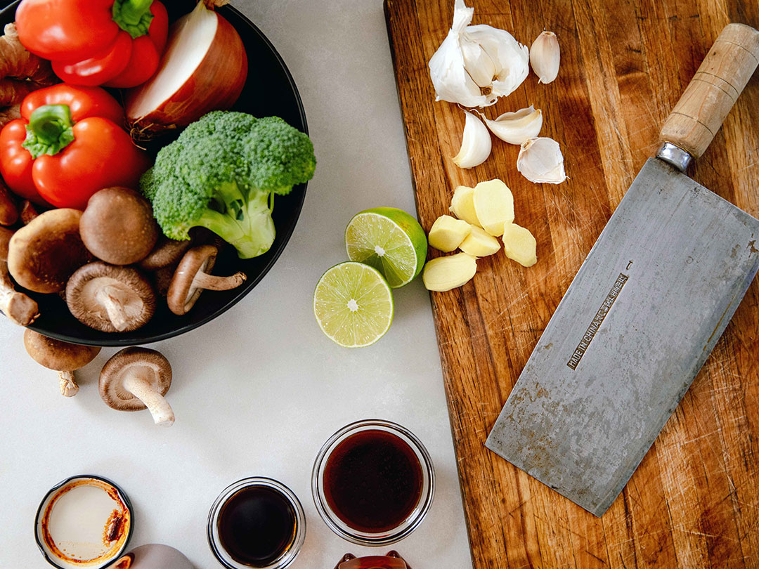 Ingredients for Chef Jet's Kung Pao sit ready on a chopping board with his heirloom cleaver.