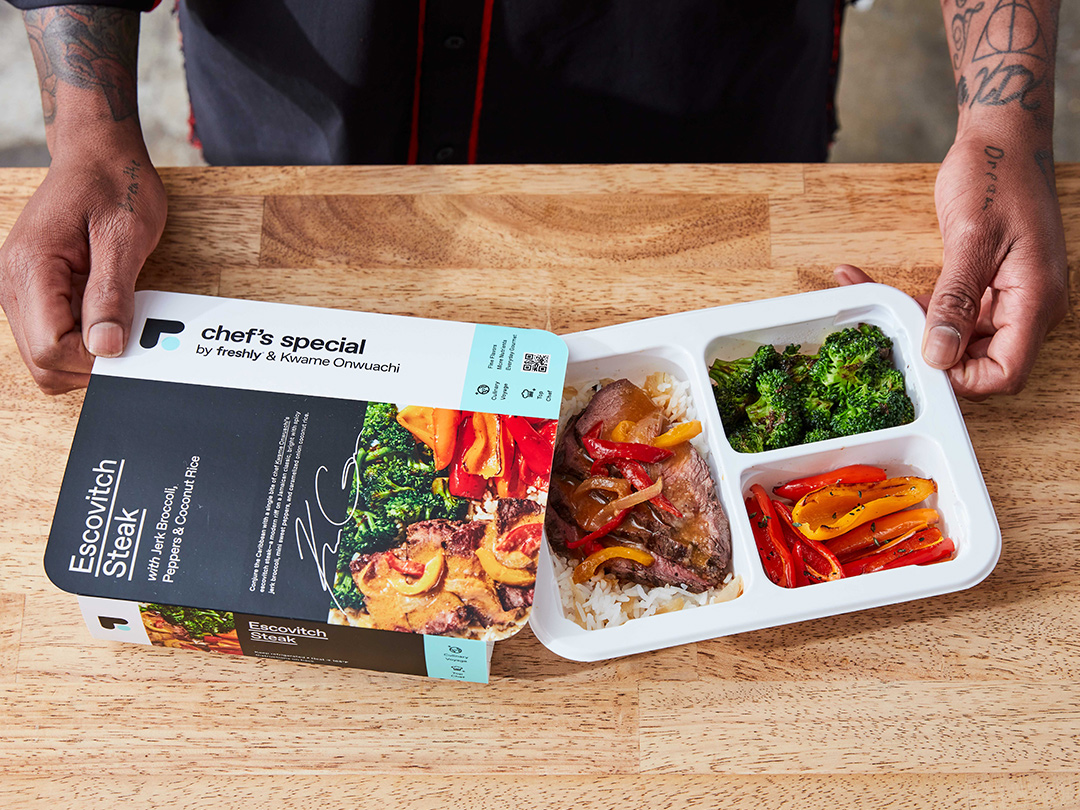 Kwame de-sleeves his dish from its packaging, revealing a tray of mouthwatering Escovitch Steak.