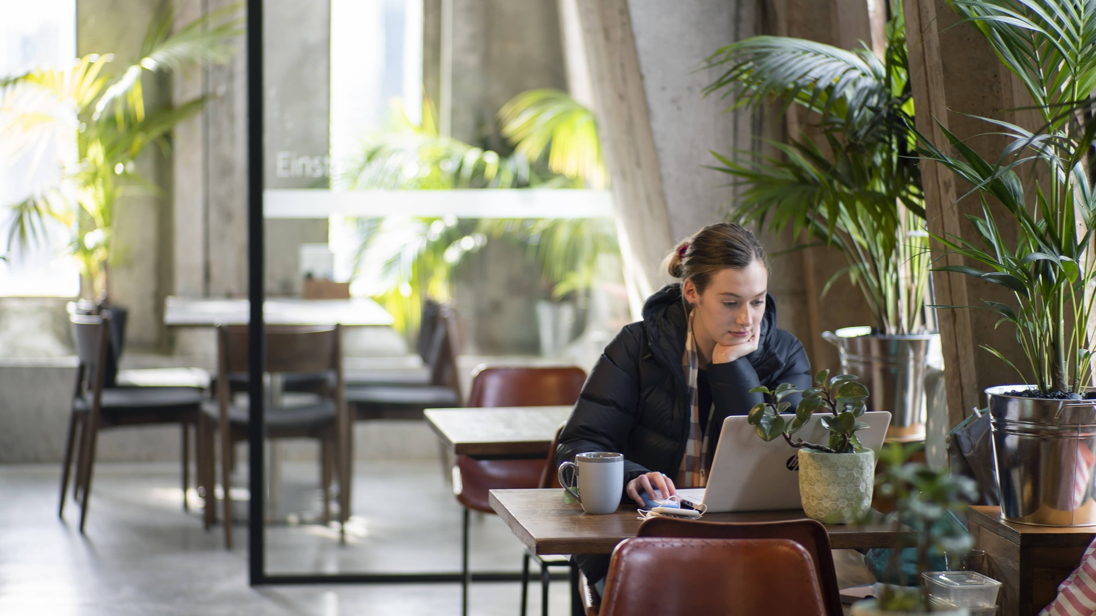 Woman working from her laptop in Melbourne CBD coworking