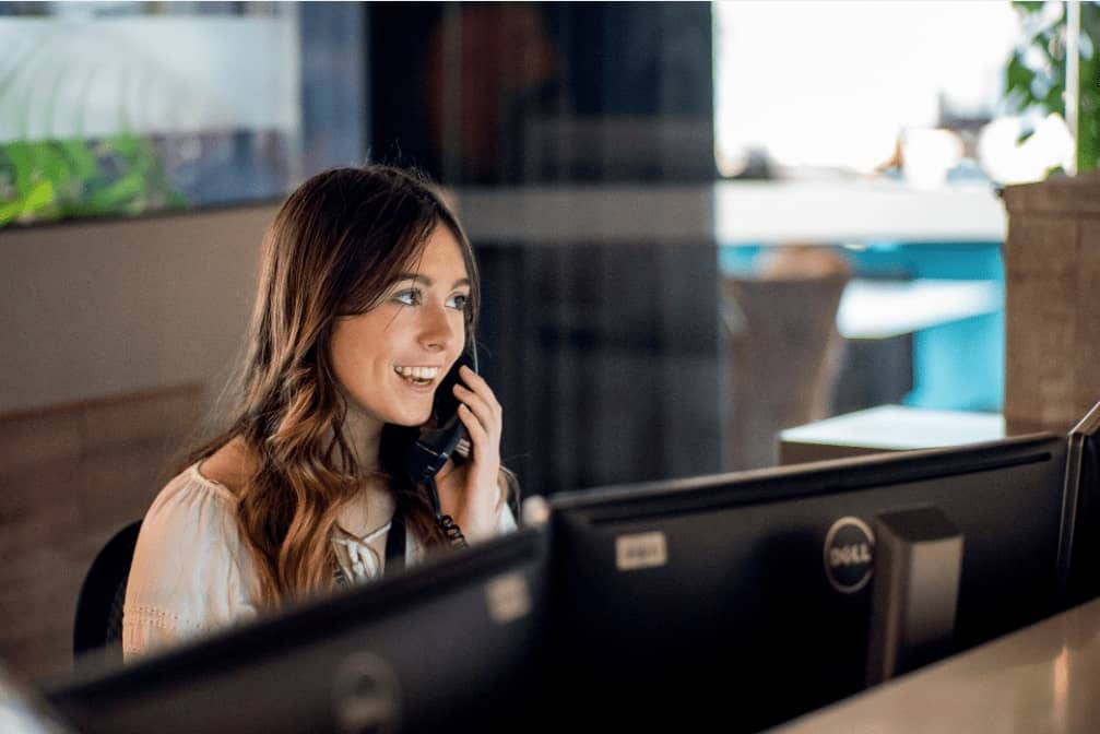 Smiling receptionist answering a call