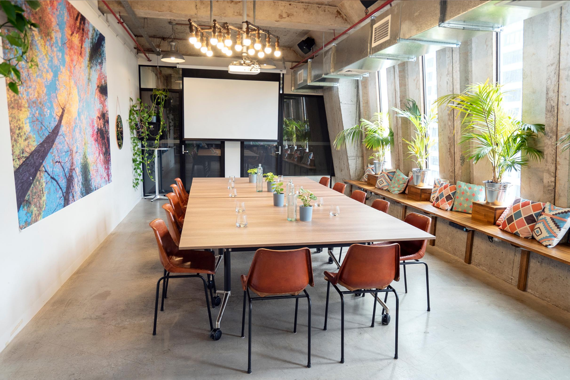 Warehouse 21 event space in Melbourne set up with a large boardroom table facing the projector