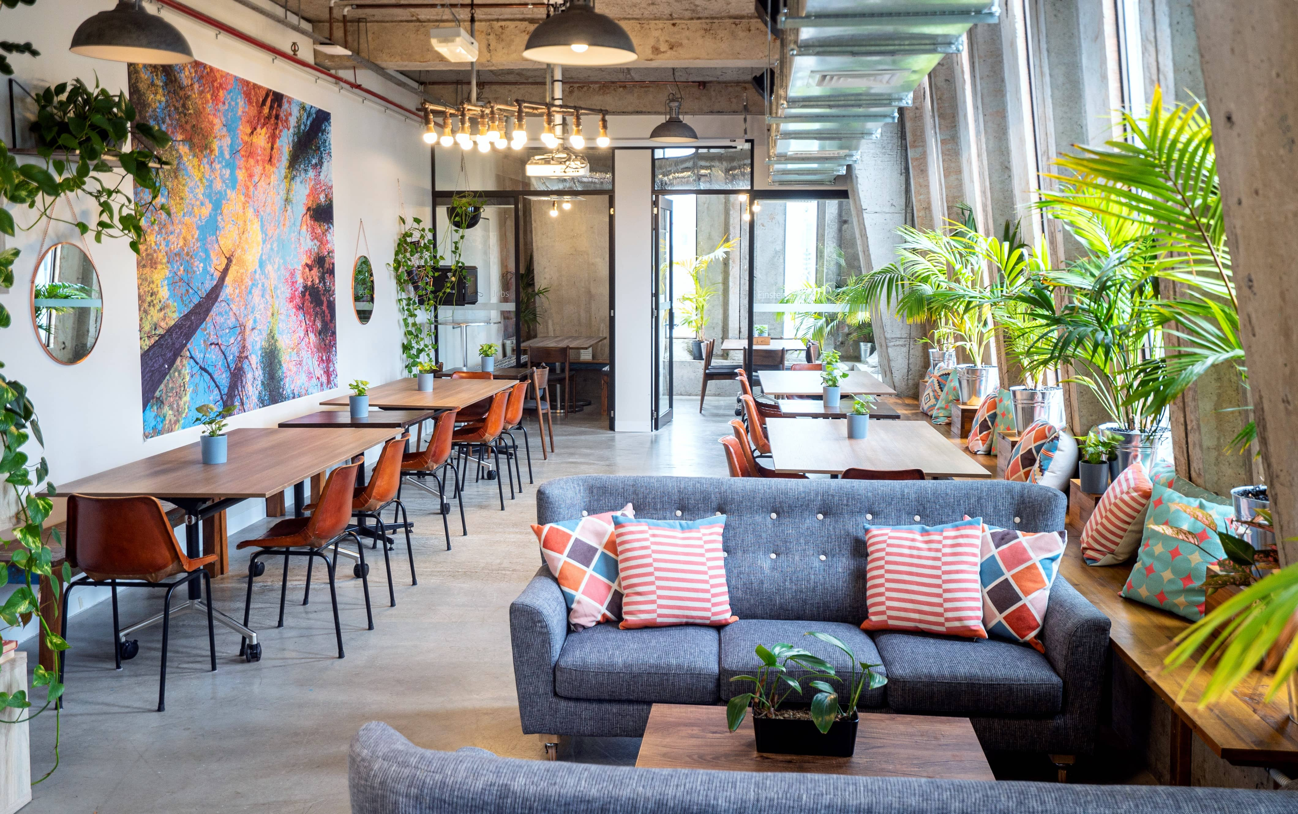 Stylish coworking communal space with sofas and cafe style seating