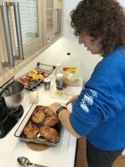 Photo of Grow participant Rachel preparing food.