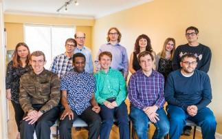 Group photo of Grow participants: Allie, Akiva, Dusty, Kenyon, Lindsey, Erica, Jordan, Ryan, Ade, Adam, Jacek, and Benji.