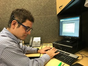 Photo of Jordan working at The Federation.