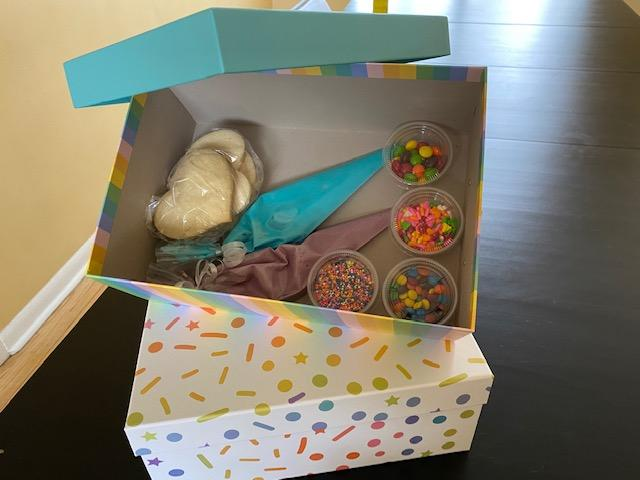 Image of a box of ingedients for the cookie decorating activity.