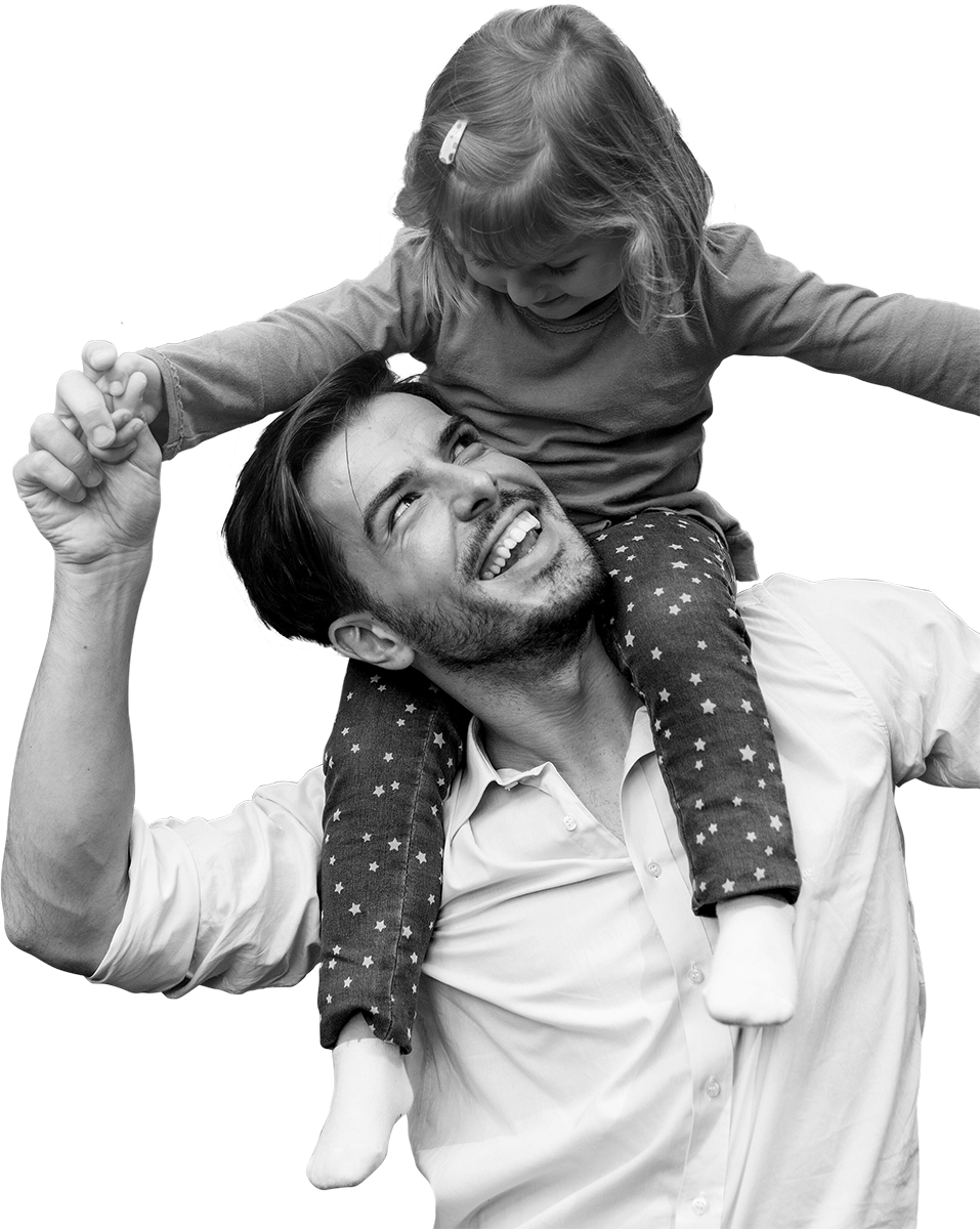 Man with young female child on shoulders smiling