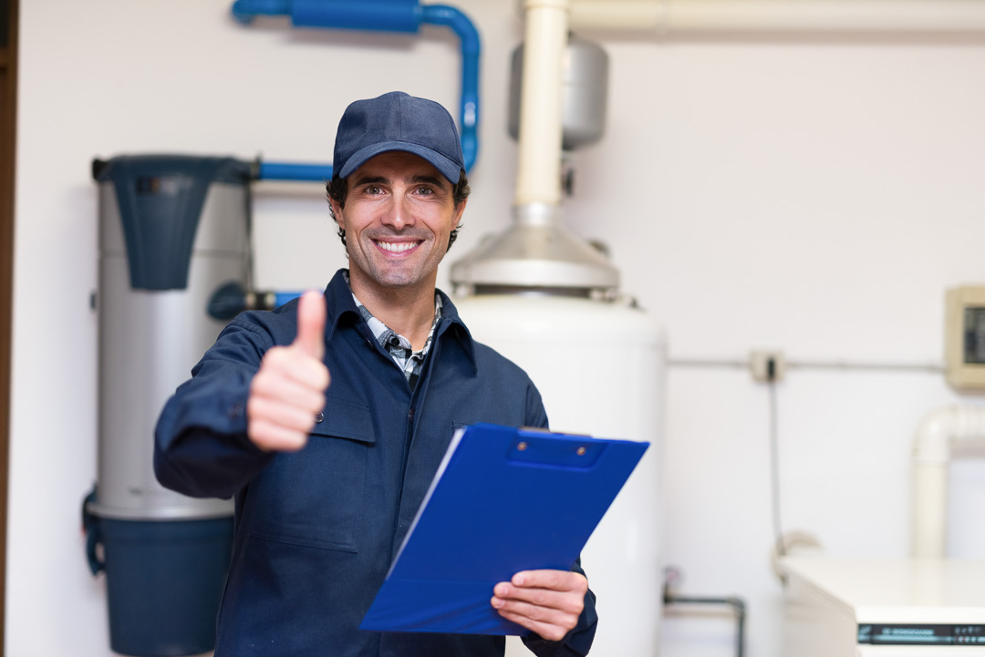 picture of man smiling inserting water heater